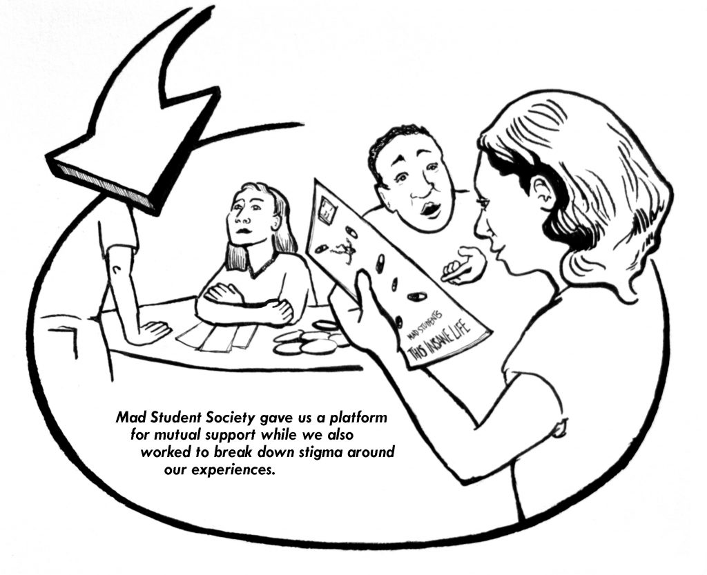 Four people sitting and standing around a table discussing and reading Mad movement literature.