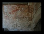 The indistinct remains of the painting in the north transept of the church at Northmoor.