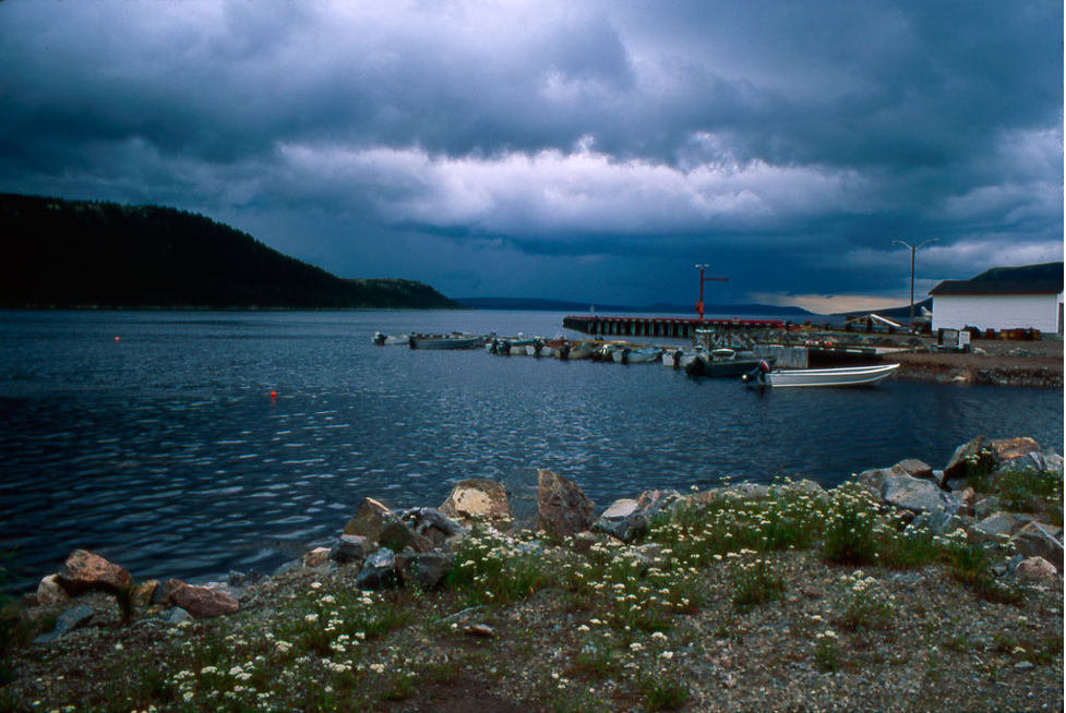 Picture of shore and dock in Rigolet, Labrador, Newfoundland on a cloudy day. Photograph by Diana Ludwig via Flickr.